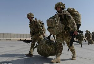 blog picture of two soldiers carrying equipment between them along with their own back packs