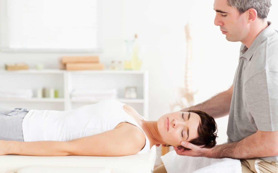 blog picture of lady on massage table getting neck adjusted by chiropractor