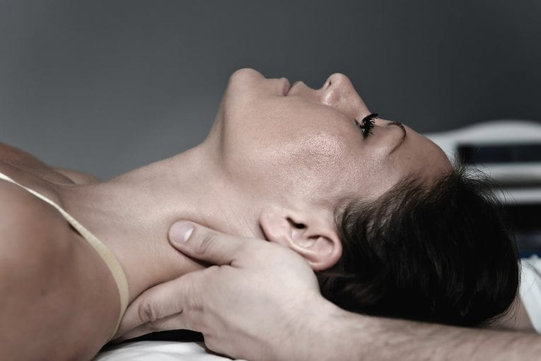 blog picture of close up of lady on table getting neck adjustment