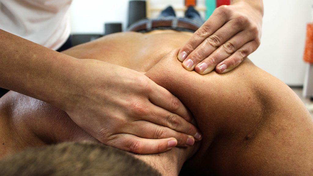 blog picture of man getting shoulder massaged