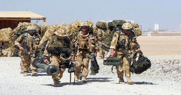 blog picture of marines carrying all their equipment