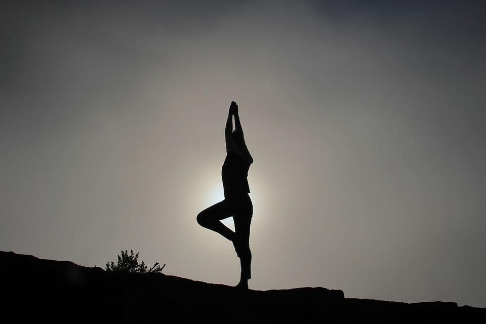 silhouette yoga standing pose