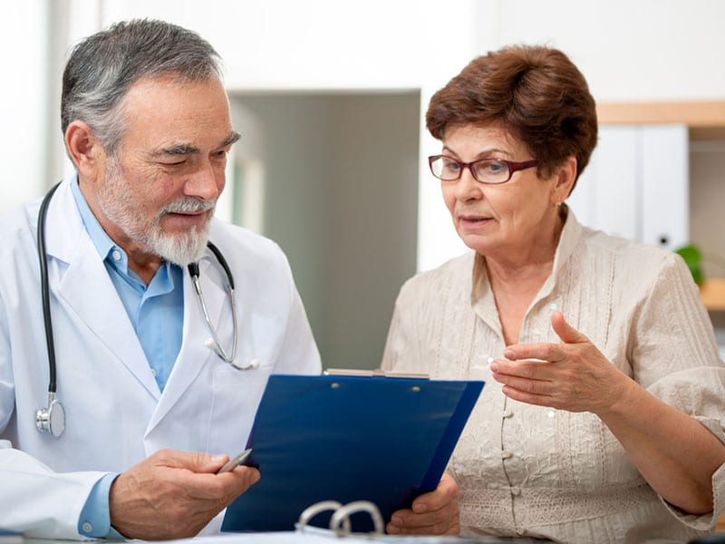 Patient talking to her doctor about her digestive health diagnosis.