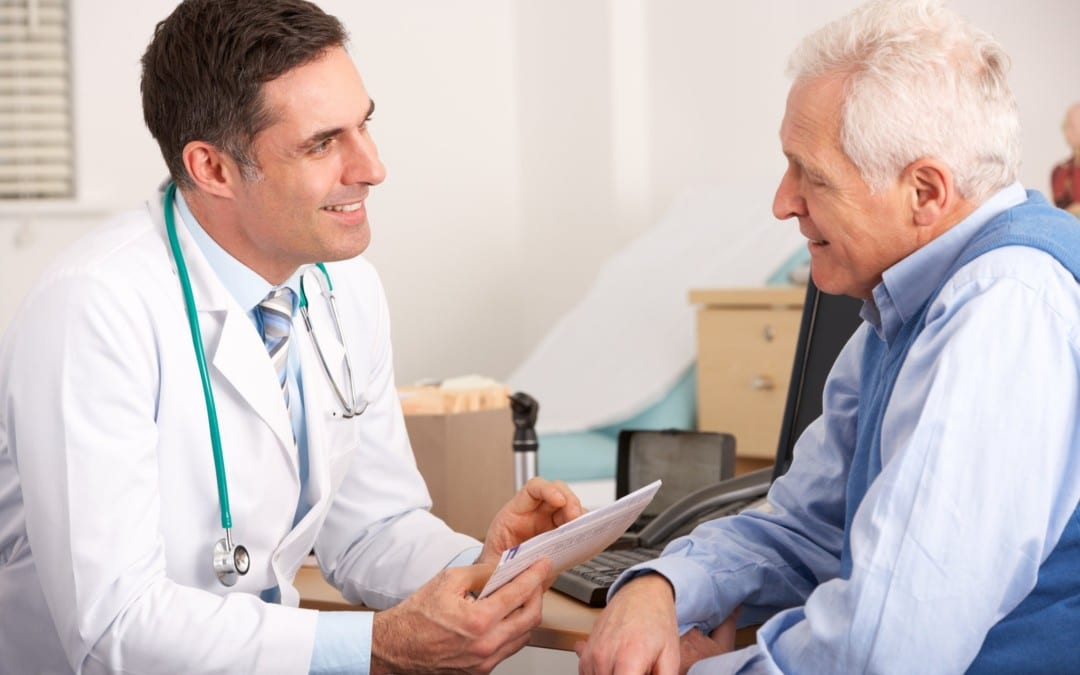 Older male patient seeing a doctor for arthritis pain management treatment.